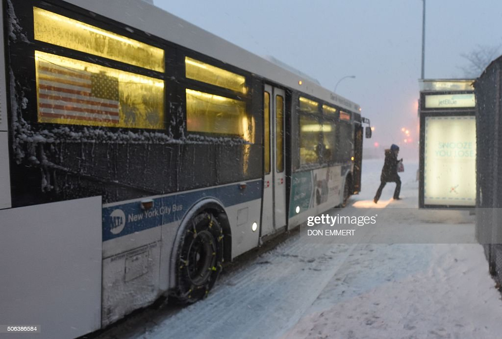 A woman exit's a NYC bus on January 23 2016 in New York A deadly blizzard with bonechilling winds and potentially recordbreaking snowfall slammed the...
