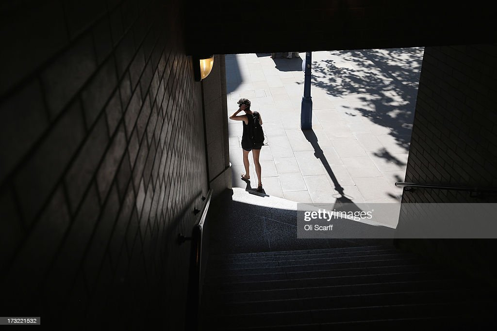 A woman exits a stepped passageway near the Tower of London on July 10, 2013 in London, England.