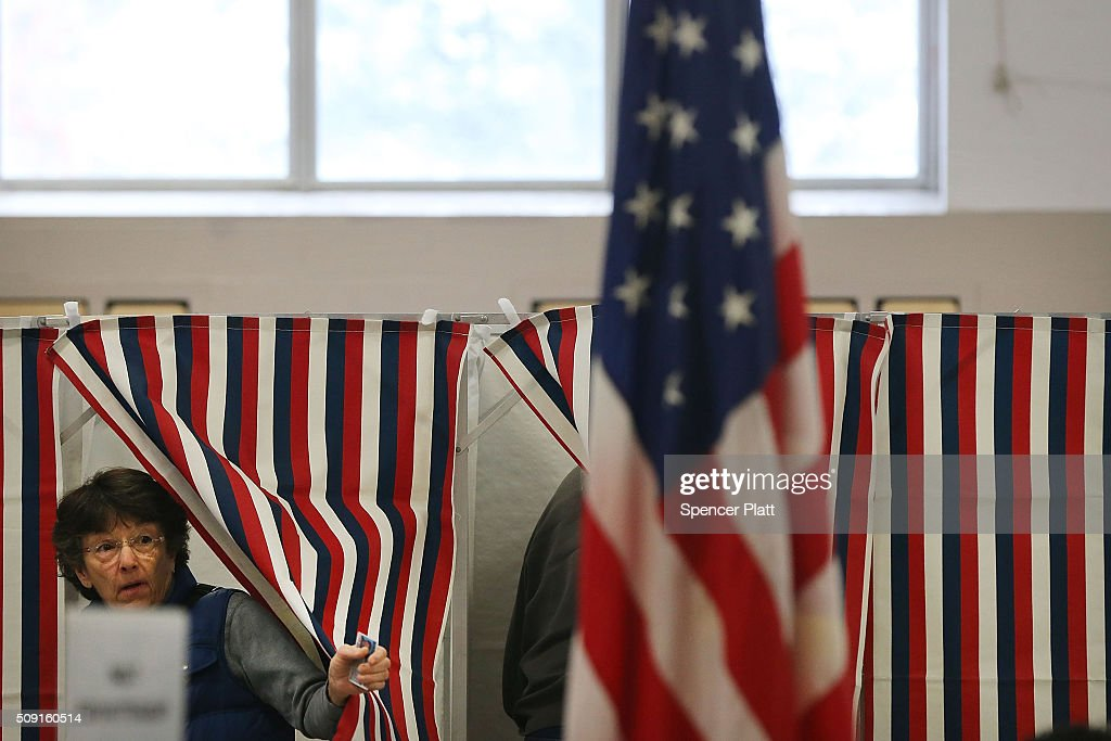 A woman exits a voting booth inside of a middle school serving as a voting station on the day of the New Hampshire Primary on February 9, 2016 in Bow, New Hampshire. After months of campaigning, voters across New Hampshire get to go to the polls today to vote for Democratic and Republican presidential candidates. Following New Hampshire, the race for the presidency moves to South Carolina.