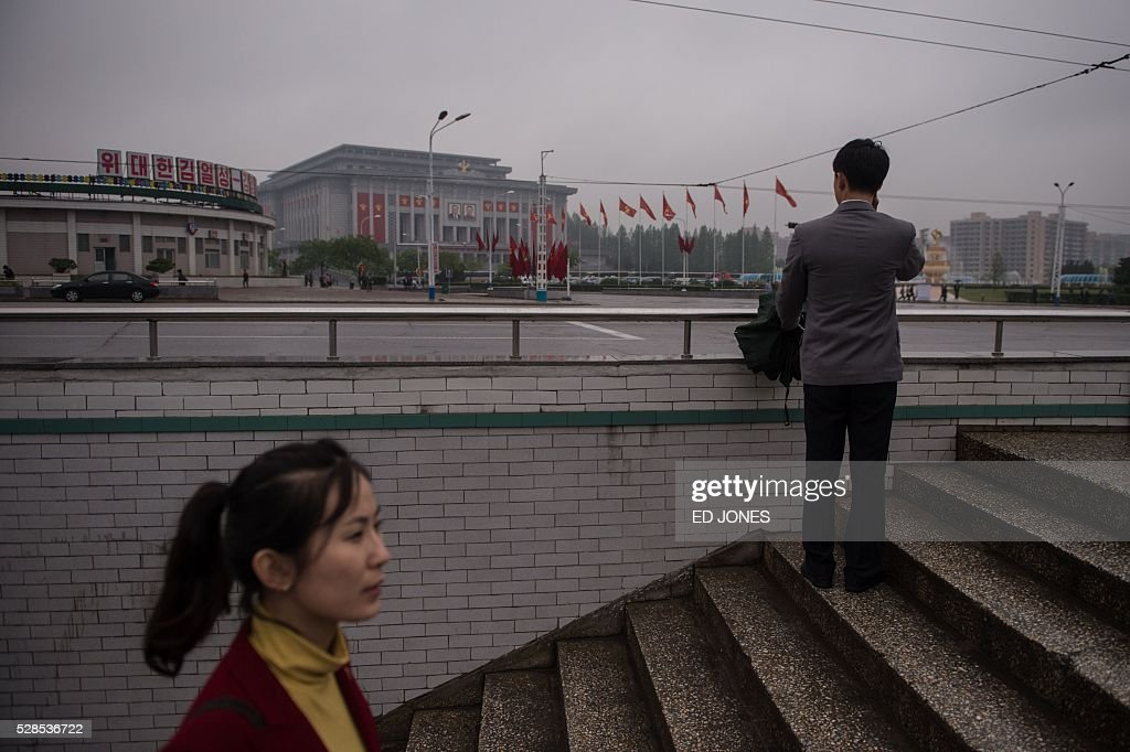 A woman exits an underpass before the 'April 25 Palace', the venue of the 7th Workers Party Congress in Pyongyang on May 6, 2016. North Korea on May 6 staged its most important political show for a generation, aimed at cementing the absolute rule of leader Kim Jong-Un and underlining the sanctions-hit country's 'prestige' as a nuclear power. / AFP / Ed Jones