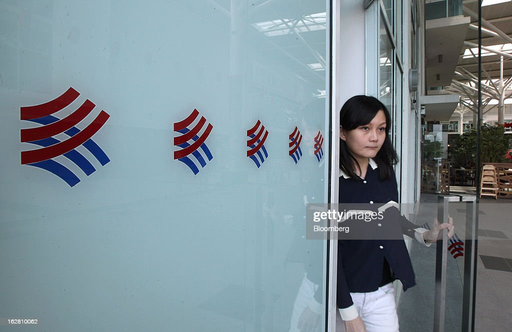 A woman exits one of Hong Leong Bank Bhd.'s Mach-branded branches in Petaling Jaya, Malaysia, on Wednesday, Feb. 27, 2013. Hong Leong Bank, the Malaysian lender controlled by billionaire Quek Leng Chan, plans to boost profit from overseas to as much as 20 percent of earnings as trade in Southeast Asia grows and emerging markets recover. Photographer: Goh Seng Chong/Bloomberg via Getty Images