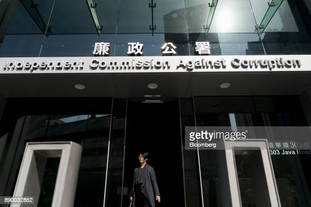 A woman exits the Hong Kong Independent Commission Against Corruption headquarters in Hong Kong China on Monday Dec 11 2017 Five months after one of...