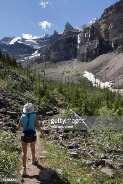 Woman explores hikes Stanley Glacier Trail Kootenay National Park British Columbia Canada