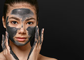 Woman face mask peeling beauty portrait. Cosmetics. Studio shot.