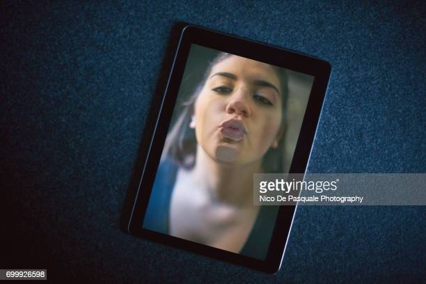 Woman face squashed on digital tablet