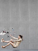 Woman falling down on pavement