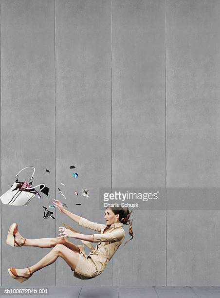 Woman falling down on pavement