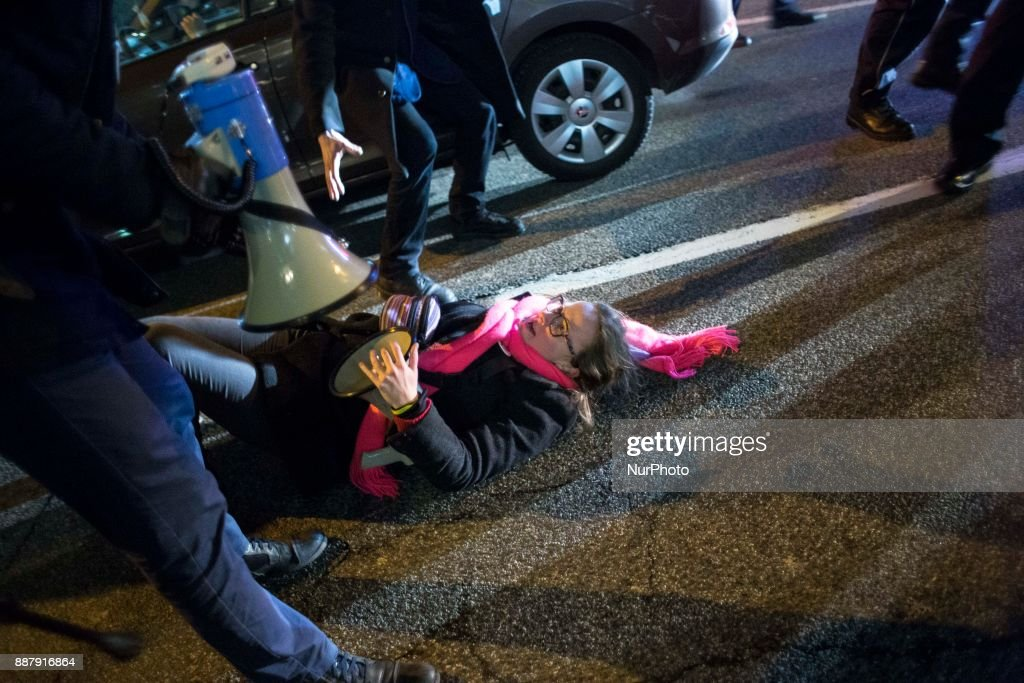 Woman falls during illegal demonstration near Polish parliament organized by opposition group Obywatele RP in Warsaw on December 7, 2017.