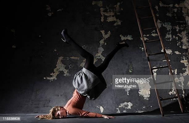 woman falls off ladder