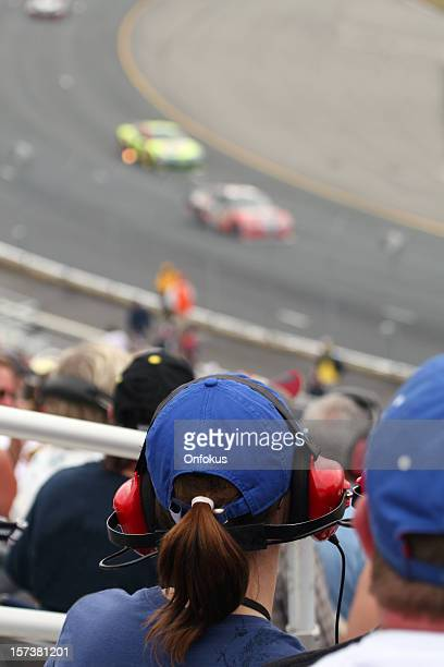 Woman Fan at Racing Event and Looking at Race