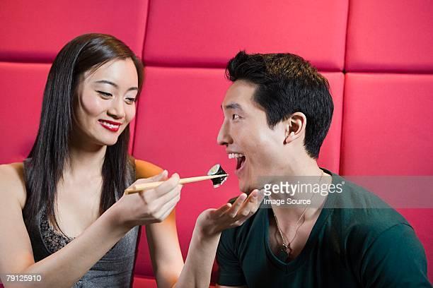 Woman feeding boyfriend