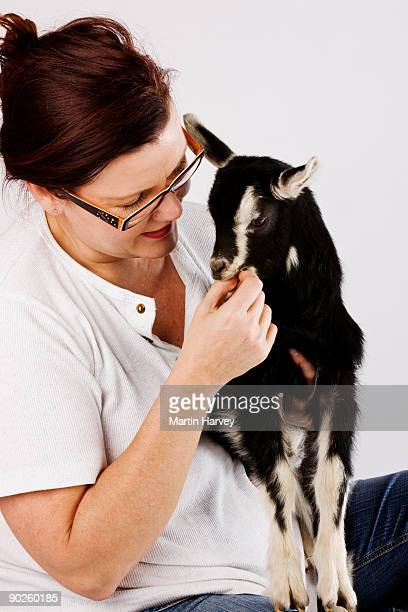 Woman feeding goat