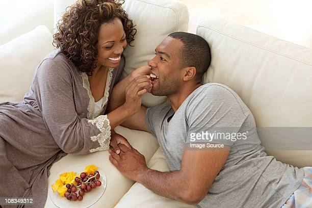 Woman feeding grapes to boyfriend