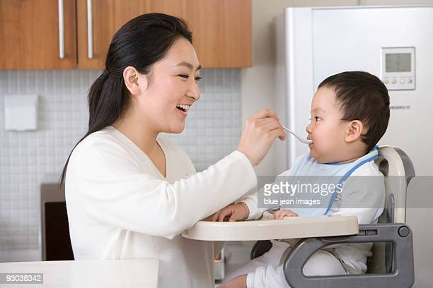 Woman feeding infant