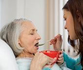 Woman feeding patient