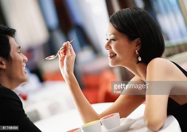 Woman Feeding Soup to Man