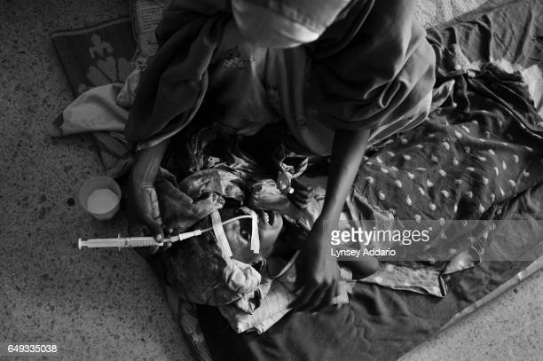 A woman feeds her malnourished son at Banadir Hospital in Mogadishu Somalia on Aug 25 2011