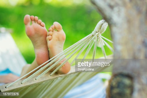 Woman feet in hammock : Stock Photo