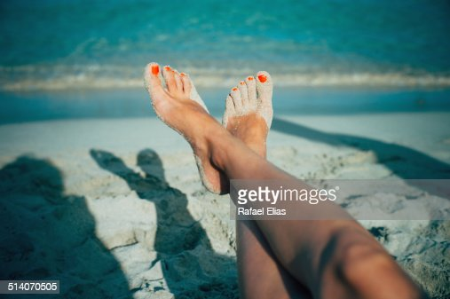 Woman feet on beach
