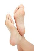 Woman feet on white background