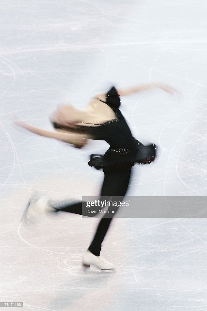 Woman figure skating with back bent : Stock Photo