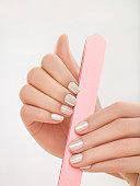 Woman filing nails, close-up