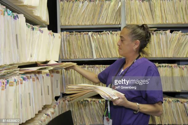 A woman filing patient records at the Borinquen Health Care Center