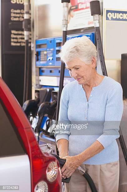 Woman filling gas tank