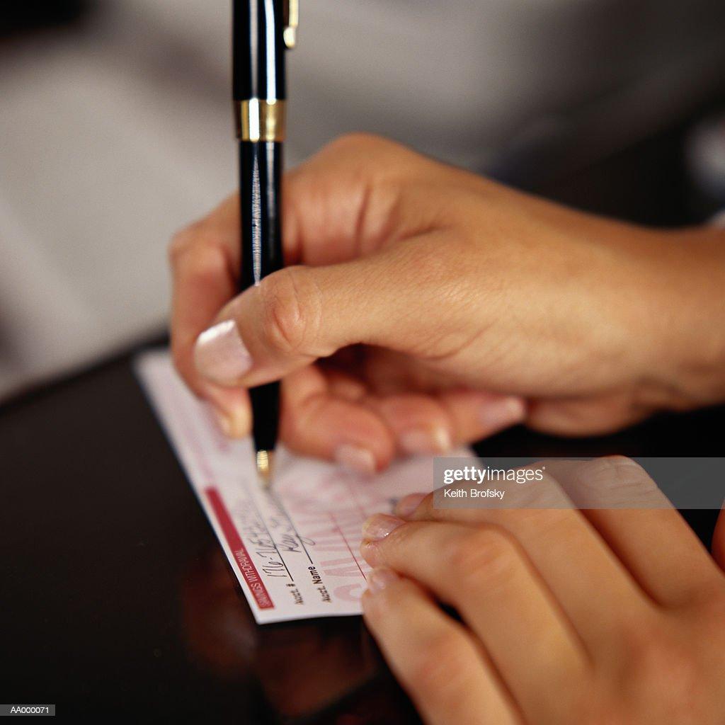 Woman Filling Out a Deposit Slip