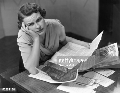 Woman filling out insurance papers : Stock Photo