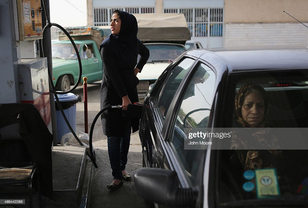A woman fills her gas tank at a service station on June 3, 2014 in Shahinshahr, Iran. Gas prices, which are regulated by the Iranian government, have risen sharply in the last month. Iran on June 4, will mark the 25th anniversary of the death of the Ayatollah Khomeini and his legacy of the Islamic Revolution.