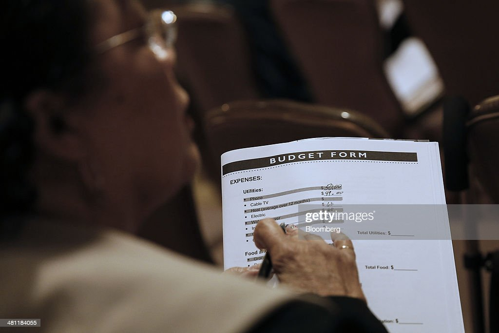 A woman fills out a budget form to receive help with home loan modifications during the Neighborhood Assistance Corporation of America (NACA) event in Los Angeles, California, U.S., on Friday, March 28, 2014. Fed buying of the securities that helped spur a housing recovery is poised to fall below growth in the $5.5 trillion government-backed market as soon as May, Nomura Holdings Inc. said. Last year, the Fed added twice as much of the debt as was created, suppressing yields that guide mortgage interest rates. Photographer: Patrick T. Fallon/Bloomberg via Getty Images