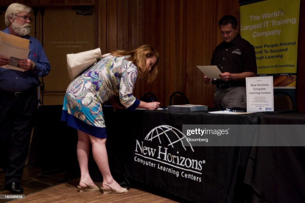A woman fills out a form as she meets a potential employer at the annual Maximum Connections job fair Thursday in Portland on Thursday, September 12, 2013. Jobless claims in the U.S. declined last week to the lowest level since April 2006 as work on computer systems in two states caused those employment agencies to report fewer applications. Photographer: Natalie Behring/Bloomberg via Getty Images News