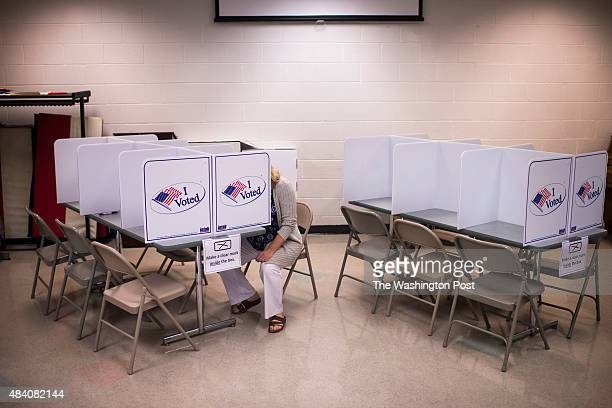 A woman fills out her ballot at the Mount Vernon Recreation Center as Alexandria residents head to the polls to vote in state and local primary...