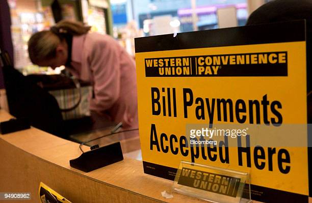 A woman fills out paperwork at a Western Union location in New York on February 3 2004 First Data Corp parent of the world's largest moneytransfer...