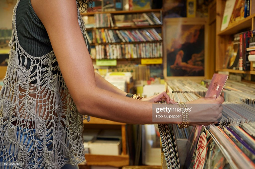 Woman finding a vinyl record