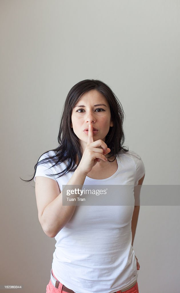 woman finger on lips : Stock Photo