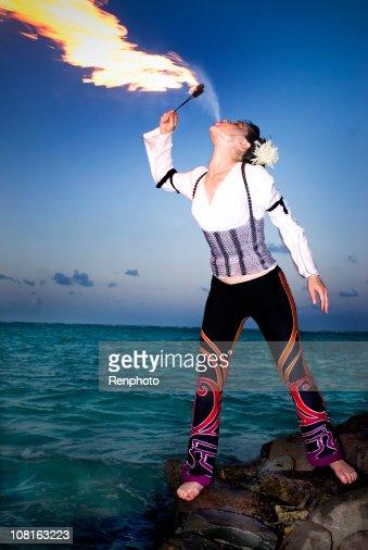 Woman Fire Breathing on Tropical Beach