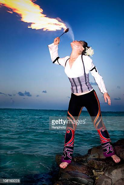Woman Fire Breathing on Tropical Beach