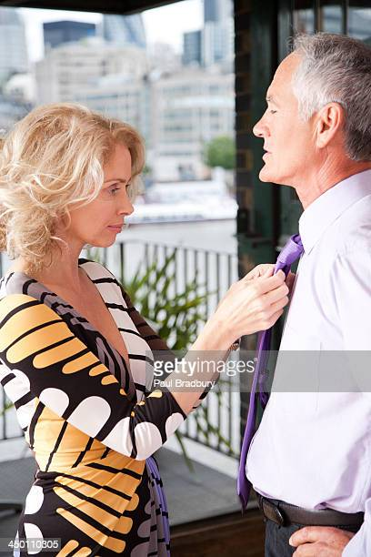 Woman fixing man's tie