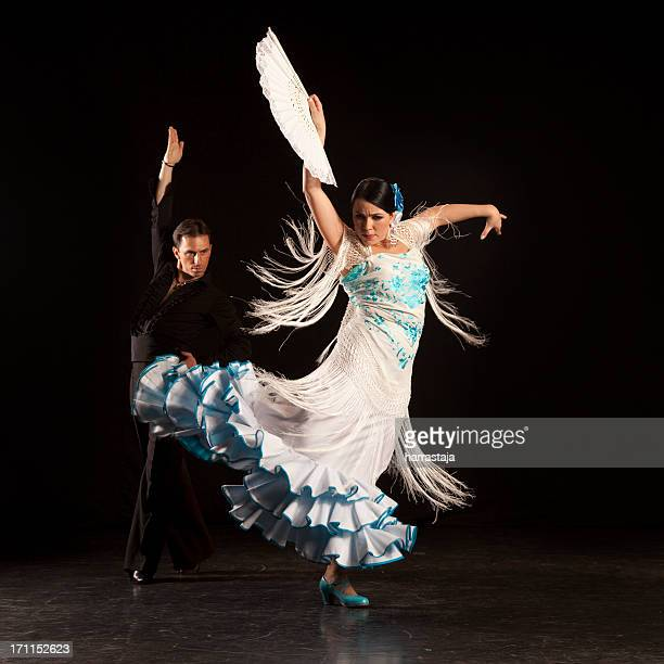 Woman flamenco dancer in blue and white with her partner