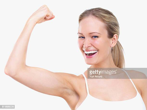 Woman flexing biceps