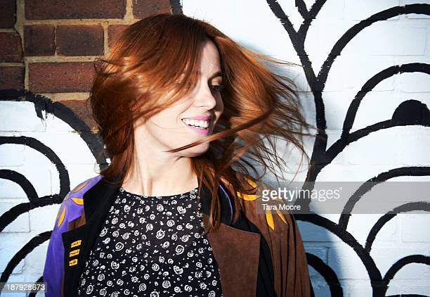 woman flicking hair and smiling