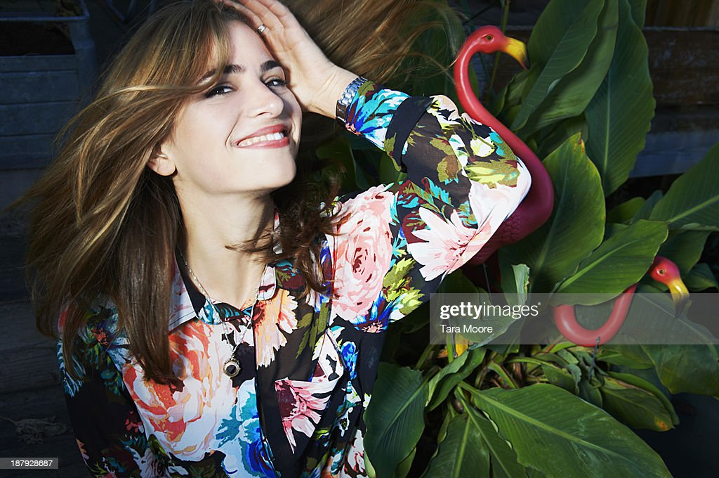 woman flicking hair and smiling : Stock Photo