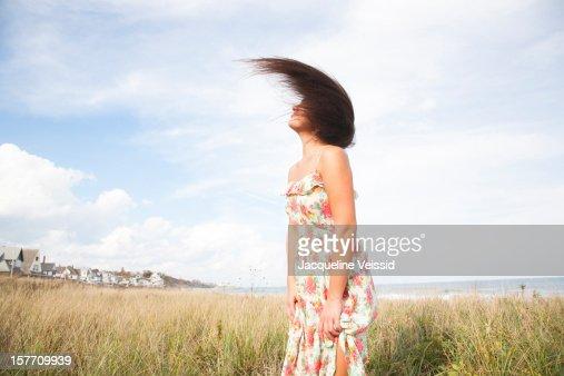 Woman flipping hair on beach : Stock Photo