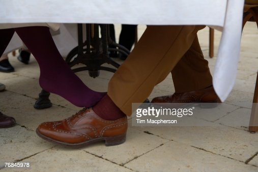 Footsie Under Table : Playing Footsie Stock Photos and Pictures  Getty Images