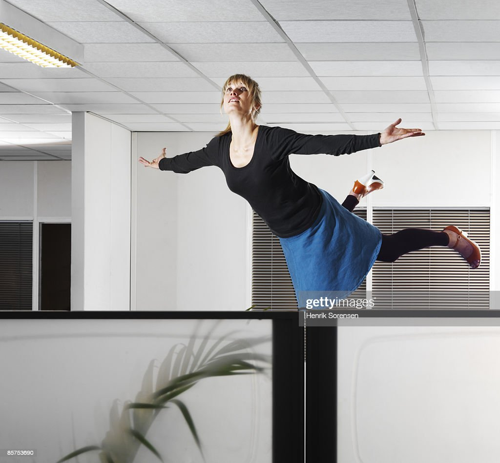 Woman floating in an office.