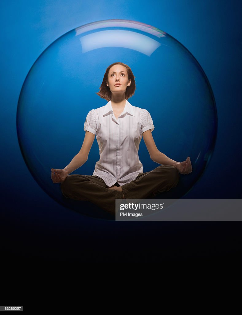 Woman floating in bubble : Stock Photo