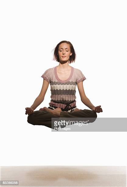 Woman floating in Yoga pose
