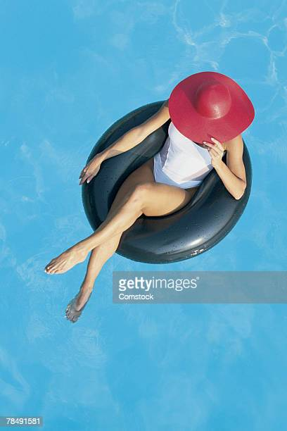 Woman floating on inner tube